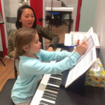 Toronto Arts Academy Girl Piano student learning piano