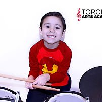 Toronto Arts Academy boy student playing drums