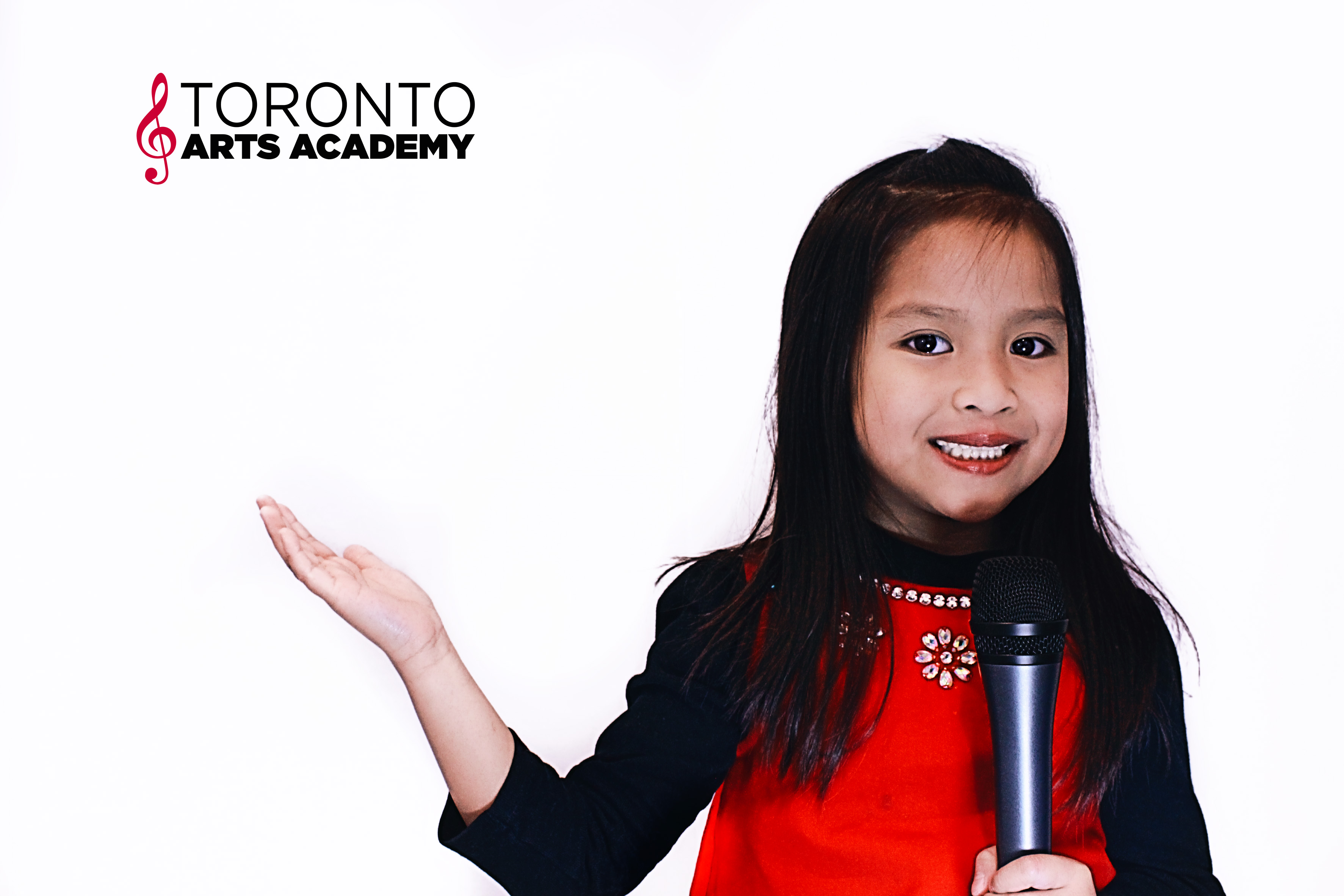 Toronto Arts Academy young girl student singing with mic