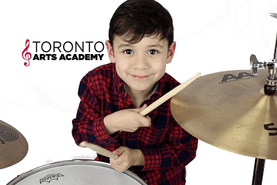 boy playing drums in drum lessons
