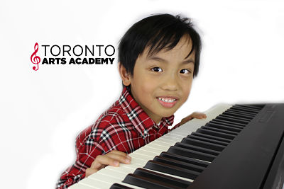 boy playing piano in lesson_opt