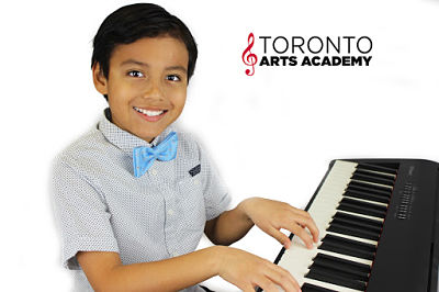 boy playing piano in piano lesson 2