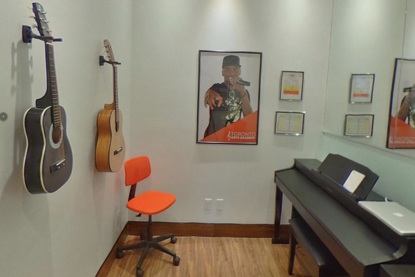 inside our piano lesson room with guitars on wall_opt
