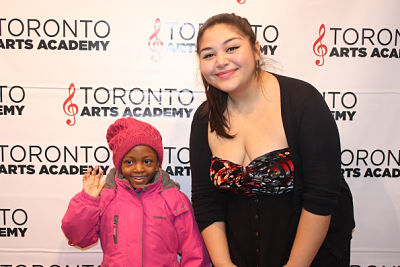 piano-teacher-Dani-with piano student on red carpet_opt