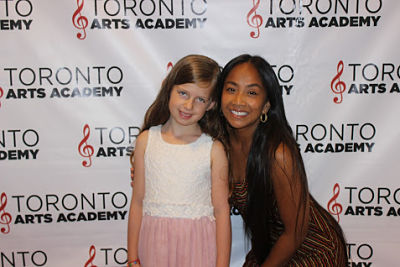 piano-teacher-michelle with piano student on red carpet