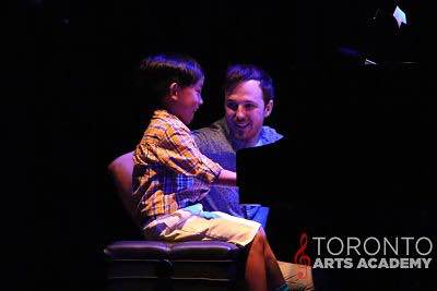Piano-lessons-toronto-teacher-in-piano-lesson-with-piano-student_opt geo