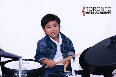 drum lesson student playing drums boy smiling-2