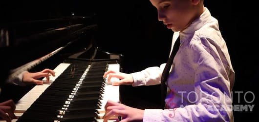 toronto-piano-lesson-student-boy-playing-piano-with-both-hands-in-shirt-and-tie_feature-2