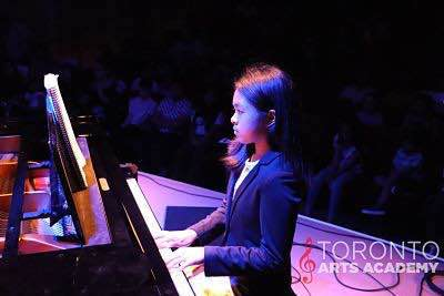toronto-piano-lessons-female-piano-student-plays-piano-onstage_geo