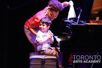 toronto-piano-lessons-teacher-in-piano-lesson-with-piano-student-onstage_geo